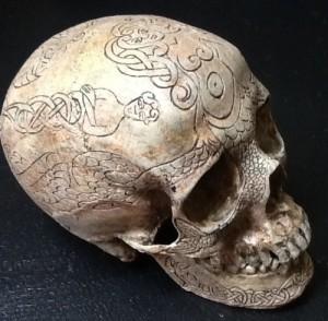 skull replica carved mermaid side